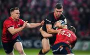 7 December 2019; Matt Gallagher of Saracens is tackled by Rory Scannell and Chris Farrell of Munster during the Heineken Champions Cup Pool 4 Round 3 match between Munster and Saracens at Thomond Park in Limerick. Photo by Brendan Moran/Sportsfile