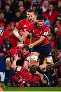 7 December 2019; Keith Earls of Munster, bottom, is congratulated by team-mates Tadhg Beirne, left, and Billy Holland, after winning possession during the Heineken Champions Cup Pool 4 Round 3 match between Munster and Saracens at Thomond Park in Limerick. Photo by Seb Daly/Sportsfile