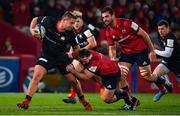 7 December 2019; Richard Barrington of Saracens is tackled by James Cronin of Munster during the Heineken Champions Cup Pool 4 Round 3 match between Munster and Saracens at Thomond Park in Limerick. Photo by Brendan Moran/Sportsfile