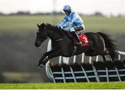 8 December 2019; Anything Will Do with JJ Slevin up, jump the second on their way to winning the W.H. Scott Lifting Supporting Wicklow GAA Rated Novice Hurdle at Punchestown Racecourse in Kildare. Photo by Harry Murphy/Sportsfile