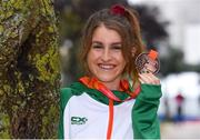 8 December 2019; Stephanie Cotter of Ireland poses for a photo with her bronze medal from the Women's U23 event during the European Cross Country Championships 2019 at Bela Vista Park in Lisbon, Portugal. Photo by Sam Barnes/Sportsfile