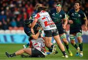 8 December 2019; Ultan Dillane of Connacht is tackled by Franco Marais, left, and Josh Hohneck of Gloucester during the Heineken Champions Cup Pool 5 Round 3 match between Gloucester and Connacht at Kingsholm Stadium in Gloucester, England. Photo by Ramsey Cardy/Sportsfile