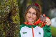8 December 2019; Stephanie Cotter of Ireland poses for a photo with her team silver and individual bronze medal from the Women's U23 event during the European Cross Country Championships 2019 at Bela Vista Park in Lisbon, Portugal. Photo by Sam Barnes/Sportsfile