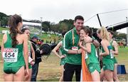 8 December 2019; Fionnuala McCormack of Ireland and physio Declan Monaghan celebrate winning team silver in the Senior Women's event during the European Cross Country Championships 2019 at Bela Vista Park in Lisbon, Portugal. Photo by Sam Barnes/Sportsfile