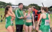 8 December 2019; Aoibhe Richardson, left, Ciara Mageean, centre, and Fionnuala McCormack of Ireland, celebrate with physio Declan Monaghan after winning team silver in the Senior Women's event during the European Cross Country Championships 2019 at Bela Vista Park in Lisbon, Portugal. Photo by Sam Barnes/Sportsfile