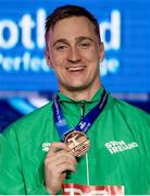 8 December 2019; Shane Ryan of Ireland showing his bronze medal of the Men's 50m Backstroke during day five of the European Short Course Swimming Championships 2019 at Tollcross International Swimming Centre in Glasgow, Scotland. Photo by Joseph Kleindl/Sportsfile