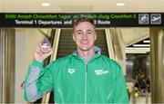 9 December 2019; Shane Ryan of Ireland with his bronze medal, from the Men's 50m Backstroke, on his return from the European Short Course Swimming Championships 2019 in Scotland at Dublin Airport in Dublin. Photo by Piaras Ó Mídheach/Sportsfile