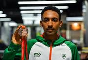 9 December 2019; Efrem Gidey of Ireland poses for a portrait with his bronze medal in the U20 Men's event during the Ireland European Cross Country Team Homecoming at Dublin Airport in Dublin. Photo by Piaras Ó Mídheach/Sportsfile