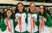 9 December 2019; Members of the silver medal winning U23 women's team, from left, Sorcha McAllister, Róisín Flanagan, Eilish Flanagan, and Claire Fagan during the Ireland European Cross Country Team Homecoming at Dublin Airport in Dublin. Photo by Piaras Ó Mídheach/Sportsfile