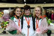 9 December 2019; Members of the silver medal winning senior women's team, from left, Aoibhe Richardson, Una Britton, and Mary Mulhare during the Ireland European Cross Country Team Homecoming at Dublin Airport in Dublin. Photo by Piaras Ó Mídheach/Sportsfile