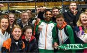 9 December 2019; Efrem Gidey of Ireland poses for a portrait with his bronze medal in the U20 Men's event with members of Clonliffe Harriers during the Ireland European Cross Country Team Homecoming at Dublin Airport in Dublin. Photo by Piaras Ó Mídheach/Sportsfile