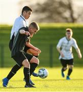 11 December 2019; Christian Dooley of FAI-ETB Cabra in action against Jamie Redmond of FAI-ETB Dundalk during the Bobby Smith Cup Round 2 game between FAI-ETB Cabra and FAI-ETB Dundalk at FAI National Training Centre in Dublin. Photo by Eóin Noonan/Sportsfile