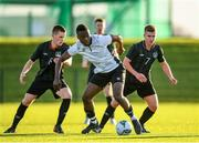 11 December 2019; Ebuka Kwelele of FAI-ETB Dundalk in action against Robert Lyons, left, and Jamie Redmond of FAI-ETB Cabra during the Bobby Smith Cup Round 2 game between FAI-ETB Cabra and FAI-ETB Dundalk at FAI National Training Centre in Dublin. Photo by Eóin Noonan/Sportsfile