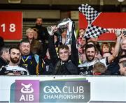 1 December 2019; Kilcoo joint captains Conor Laverty and Aidan Branagan watch the recovering Caelan McEvoy lift the cup after the AIB Ulster GAA Football Senior Club Championship Final match between Kilcoo and Naomh Conaill at Healy Park in Omagh, Tyrone. Photo by Oliver McVeigh/Sportsfile