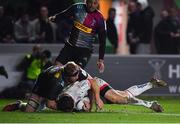 13 December 2019; John Cooney of Ulster dives over to score his side's first try, despite the tackle of James Chisholm of Harlequins, during the Heineken Champions Cup Pool 3 Round 4 match between Harlequins and Ulster at Twickenham Stoop in London, England. Photo by Seb Daly/Sportsfile