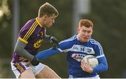 14 December 2019; Colm Murphy of Laois in action against Jim Rossiter of Wexford during the 2020 O'Byrne Cup Round 2 match between Wexford and Laois at St Patrick's Park in Enniscorthy, Wexford. Photo by Eóin Noonan/Sportsfile