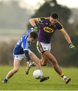 14 December 2019; Alan Kinsella of Laois is tackled by Glen Malone of Wexford during the 2020 O'Byrne Cup Round 2 match between Wexford and Laois at St Patrick's Park in Enniscorthy, Wexford. Photo by Eóin Noonan/Sportsfile