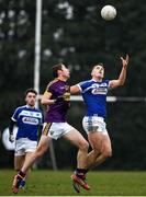 14 December 2019; John O'Loughlin of Laois in action against Colm Feeney of Wexford during the 2020 O'Byrne Cup Round 2 match between Wexford and Laois at St Patrick's Park in Enniscorthy, Wexford. Photo by Eóin Noonan/Sportsfile