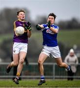 14 December 2019; Mark Rossiter of Wexford in action against Brian Byrne of Laois during the 2020 O'Byrne Cup Round 2 match between Wexford and Laois at St Patrick's Park in Enniscorthy, Wexford. Photo by Eóin Noonan/Sportsfile