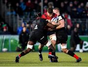 14 December 2019; Jack O'Donoghue of Munster is tackled by Joel Kpoku, left, and George Kruis of Saracens during the Heineken Champions Cup Pool 4 Round 4 match between Saracens and Munster at Allianz Park in Barnet, England. Photo by Seb Daly/Sportsfile