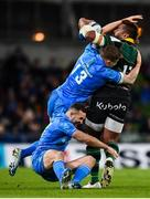 14 December 2019; Taqele Naiyaravoro of Northampton Saints is tackled by Garry Ringrose, 13, and Dave Kearney of Leinster during the Heineken Champions Cup Pool 1 Round 4 match between Leinster and Northampton Saints at the Aviva Stadium in Dublin. Photo by Stephen McCarthy/Sportsfile