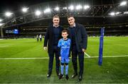 14 December 2019; Mascot 10 year old Jamie Winston, from Greystones, Co. Wicklow, with Leinster players Dan Leavy and Jonathan Sexton at the Heineken Champions Cup Pool 1 Round 4 match between Leinster and Northampton Saints at the Aviva Stadium in Dublin. Photo by Ramsey Cardy/Sportsfile