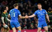 14 December 2019; Ciarán Frawley, right, congratulates Leinster team-mate Garry Ringrose on scoring a try during the Heineken Champions Cup Pool 1 Round 4 match between Leinster and Northampton Saints at the Aviva Stadium in Dublin. Photo by Ramsey Cardy/Sportsfile