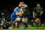 14 December 2019; Caelan Doris of Leinster is tackled by Connor Tupai, left, and Jamie Gibson of Northampton Saints during the Heineken Champions Cup Pool 1 Round 4 match between Leinster and Northampton Saints at the Aviva Stadium in Dublin. Photo by Ramsey Cardy/Sportsfile