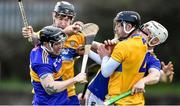 15 December 2019; Willie Connors of Tipperary, supported by team-mate Paul Flynn, right, in action against Kevin Hehir, left, and Eoin Quirke of Clare during the Co-op Superstores Munster Hurling League 2020 Group A match between Tipperary and Clare at McDonagh Park in Nenagh, Tipperary. Photo by Piaras Ó Mídheach/Sportsfile