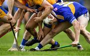 15 December 2019; Paul Flynn of Tipperary tries to gather possession ahead of Jack Browne of Clare, centre, during the Co-op Superstores Munster Hurling League 2020 Group A match between Tipperary and Clare at McDonagh Park in Nenagh, Tipperary. Photo by Piaras Ó Mídheach/Sportsfile