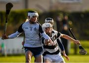 17 December 2019; Paddy Doyle of Dublin North Schools in action against Cian Kenny of St Kieran's College during the Top Oil Leinster Schools Senior A Hurling Championship First Round match between Dublin North Schools and St Kieran's College at Naomh Barróg GAA Club in Kilbarrack, Dublin. Photo by Harry Murphy/Sportsfile
