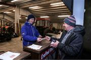 20 December 2019; Ticket seller, James Donegan hands a ticket to Mick Meade from Newcestown, West Cork, before the Co-op Superstores Munster Hurling League 2020 Group B match between Cork and Kerry at Mallow GAA Grounds in Mallow, Cork. Photo by Matt Browne/Sportsfile