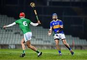 20 December 2019; John McGrath of Tipperary in action against Barry Nash of Limerick during the Co-op Superstores Munster Hurling League 2020 Group A match between Limerick and Tipperary at LIT Gaelic Grounds in Limerick. Photo by Piaras Ó Mídheach/Sportsfile
