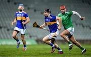 20 December 2019; Willie Connors of Tipperary gets past Barry Nash of Limerick during the Co-op Superstores Munster Hurling League 2020 Group A match between Limerick and Tipperary at LIT Gaelic Grounds in Limerick. Photo by Piaras Ó Mídheach/Sportsfile