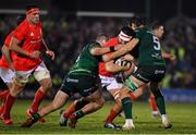 21 December 2019; Jean Kleyn of Munster is tackled by Finlay Bealham, left, and Quinn Roux of Connacht during the Guinness PRO14 Round 8 match between Connacht and Munster at The Sportsground in Galway. Photo by Brendan Moran/Sportsfile