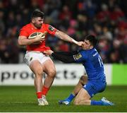 28 December 2019; Sammy Arnold of Munster is tackled by Jimmy O'Brien of Leinster during the Guinness PRO14 Round 9 match between Munster and Leinster at Thomond Park in Limerick. Photo by Ramsey Cardy/Sportsfile