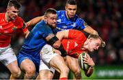28 December 2019; Mike Haley of Munster is tackled by Andrew Porter of Leinster during the Guinness PRO14 Round 9 match between Munster and Leinster at Thomond Park in Limerick. Photo by Ramsey Cardy/Sportsfile
