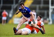 29 December 2019; Rian O'Neill of Armagh is tackled by Kian Monahan of Cavan during the Bank of Ireland Dr McKenna Cup Round 1 match between Cavan and Armagh at Kingspan Breffni in Cavan. Photo by Ben McShane/Sportsfile