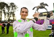 29 December 2019; Patrick Mullins celebrates with the trophy after winning the Matheson Hurdle on Sharjah during Day Four of the Leopardstown Christmas Festival 2019 at Leopardstown Racecourse in Dublin. Photo by David Fitzgerald/Sportsfile