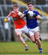29 December 2019; Ryan Connolly of Cavan in action against Conor Turbit of Armagh during the Bank of Ireland Dr McKenna Cup Round 1 match between Cavan and Armagh at Kingspan Breffni in Cavan. Photo by Ben McShane/Sportsfile