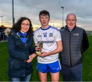 29 December 2019; Man of the match, Aaron Mulligan being presented with his trophy by Bronagh Connaughton and John Connolly following the Bank of Ireland Dr McKenna Cup Round 1 match between Monaghan and Derry at Grattan Park in Inniskeen, Monaghan. Photo by Philip Fitzpatrick/Sportsfile