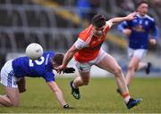 29 December 2019; Aiden Nugent of Armagh and Patrick Meade of Cavan during the Bank of Ireland Dr McKenna Cup Round 1 match between Cavan and Armagh at Kingspan Breffni in Cavan. Photo by Ben McShane/Sportsfile