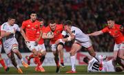 3 January 2020; Andrew Conway of Munster is tackled by Stuart McCloskey of Ulster during the Guinness PRO14 Round 10 match between Ulster and Munster at Kingspan Stadium in Belfast. Photo by Ramsey Cardy/Sportsfile