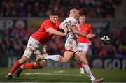 3 January 2020; John Cooney of Ulster in action against Jack O'Donoghue of Munster during the Guinness PRO14 Round 10 match between Ulster and Munster at Kingspan Stadium in Belfast. Photo by Ramsey Cardy/Sportsfile