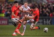 3 January 2020; Will Addison of Ulster kicks under pressure from Conor Murray and Jack O'Donoghue of Munster during the Guinness PRO14 Round 10 match between Ulster and Munster at Kingspan Stadium in Belfast. Photo by Harry Murphy/Sportsfile