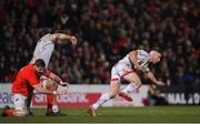 3 January 2020; John Cooney of Ulster escapes the tackle by Darren O'Shea of Munster during the Guinness PRO14 Round 10 match between Ulster and Munster at Kingspan Stadium in Belfast. Photo by Ramsey Cardy/Sportsfile