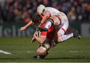3 January 2020; Jack O'Donoghue of Munster is tackled by Luke Marshall of Ulster during the Guinness PRO14 Round 10 match between Ulster and Munster at Kingspan Stadium in Belfast. Photo by Harry Murphy/Sportsfile