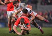 3 January 2020; Dan Goggin of Munster is tackled by Jacob Stockdale and Sean Reidy of Ulster during the Guinness PRO14 Round 10 match between Ulster and Munster at Kingspan Stadium in Belfast. Photo by Ramsey Cardy/Sportsfile