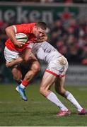 3 January 2020; Dan Goggin of Munster is tackled by Jacob Stockdale of Ulster during the Guinness PRO14 Round 10 match between Ulster and Munster at Kingspan Stadium in Belfast. Photo by Harry Murphy/Sportsfile