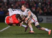 3 January 2020; Dan Goggin of Munster is tackled by Jacob Stockdale and Will Addison of Ulster during the Guinness PRO14 Round 10 match between Ulster and Munster at Kingspan Stadium in Belfast. Photo by Harry Murphy/Sportsfile